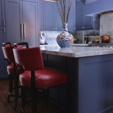 beautiful kitchen paint in blue with red chairs
