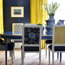 luxury dining room with blue wall painting and yellow window cover - unique homes