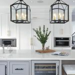 beautiful kitchens - white kitchen cabinets with golden trim and custom wall mural