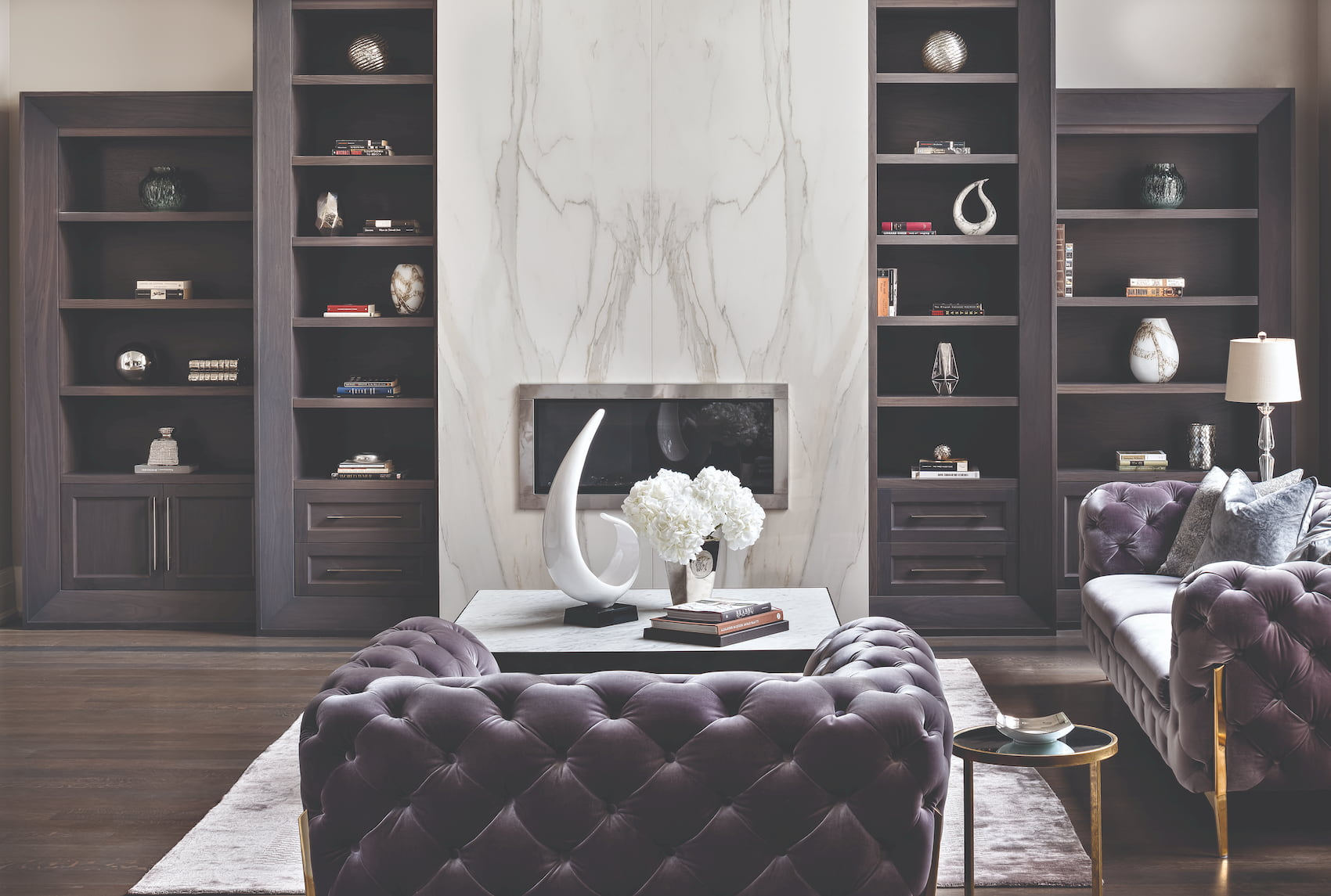 luxury living room with marble wall decor and build in fireplace
