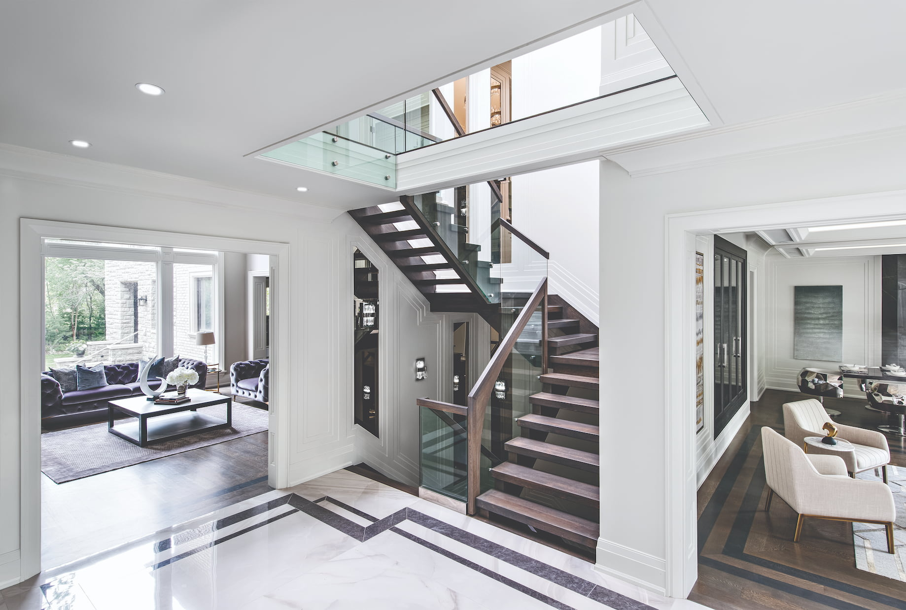 custom staircase with wooden stairs and railings with glass