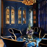 beautiful blue dining room with storage cabinet and blue carpet