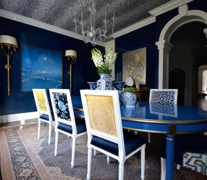 custom dining room with blue wall painting and blue dining table