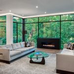 amazing living room with huge windows and build in fire place