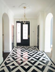 front door hallway with luxury floor decor