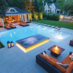 custom backyard with amazing interlocking and swimming pool - patio design ideas