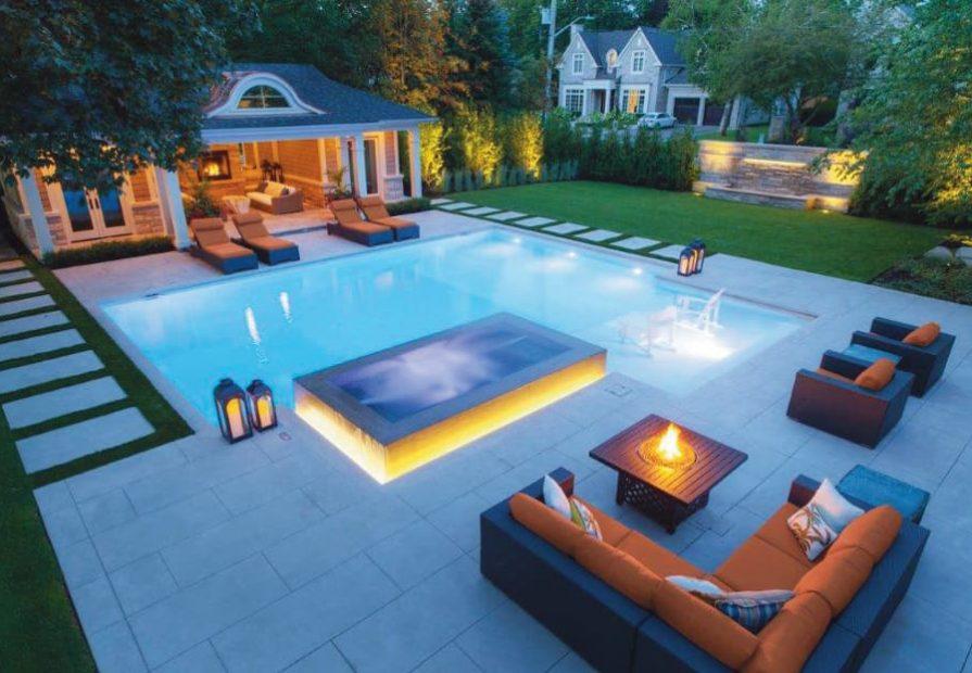 custom backyard with amazing interlocking and swimming pool - patio design ideas