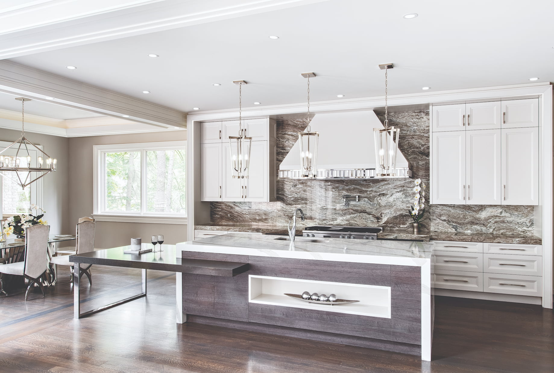 modern kitchen with marble wall decor and ceiling pot lights