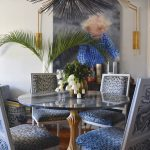 custom dining room with custom wall painting and glass table