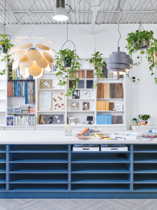 office space with blue storage space and white shelve unit