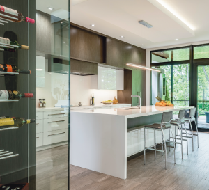 modern kitchen with wooden cabinets and wine cellar