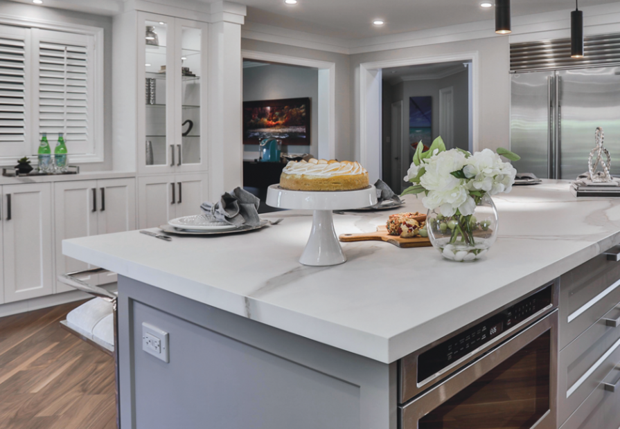 timeless kitchen design with build in appliances and gray luxury island with storage space